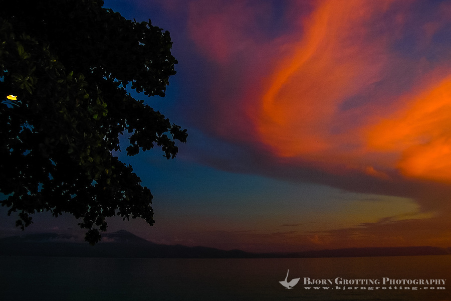 Indonesia, Sulawesi, Bunaken. Sunset at Bunaken. Looking towards Manado city.