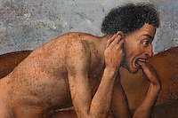 One of the damned, pulling his ear and biting his hand, on his way to hell, from the open panels of the polyptych altarpiece, 1446-52, by Rogier van der Weyden, 1399-1464, commissioned by Nicolas Rolin in 1443, in Les Hospices de Beaune, or Hotel-Dieu de Beaune, a charitable almshouse and hospital for the poor, built 1443-57 by Flemish architect Jacques Wiscrer, and founded by Nicolas Rolin, chancellor of Burgundy, and his wife Guigone de Salins, in Beaune, Cote d'Or, Burgundy, France. The altarpiece was originally in the Chapel, but is now in the museum. The panels were only opened to patients during holy days. The hospital was run by the nuns of the order of Les Soeurs Hospitalieres de Beaune, and remained a hospital until the 1970s. The building now houses the Musee de l'Histoire de la Medecine, or Museum of the History of Medicine, and is listed as a historic monument. Picture by Manuel Cohen