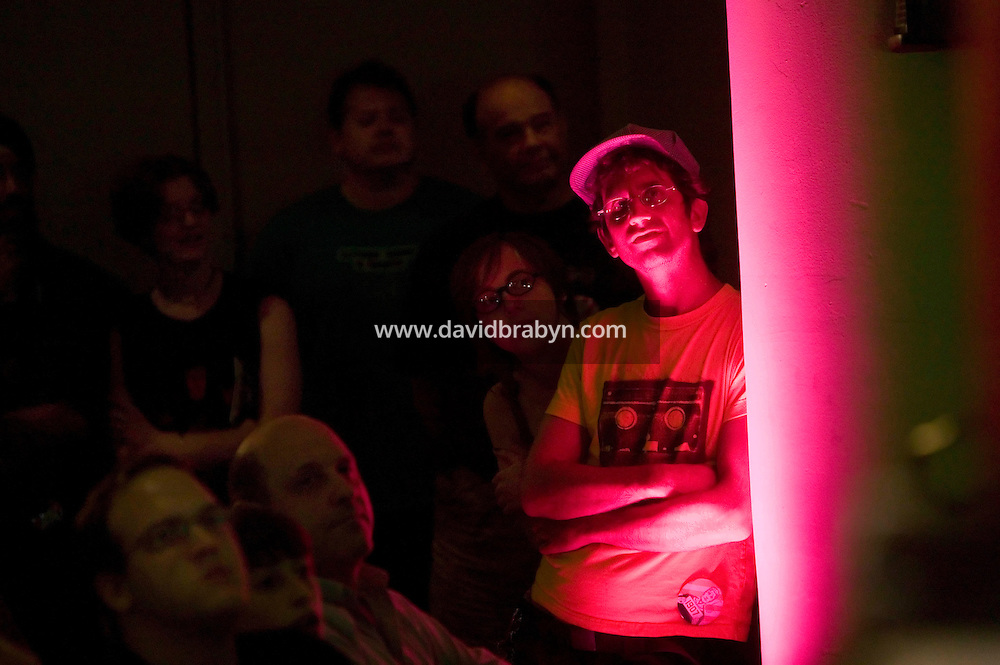 Attendees of the 6th edition of HOPE, an annual hackers' convention, listen to speakers during the closing events, July 23rd 2006, New York City, USA.