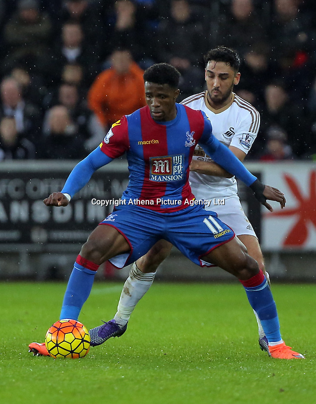 (L-R) Wilfried Zaha of Crystal Palace challenged by Neil Taylor of Swansea during the Barclays Premier League match between Swansea City and Crystal Palace at the Liberty Stadium, Swansea on February 06 2016