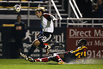 20 March 2004: Nigel Henry (right) tackles the ball away from Bobby Convey (15) during the first half. DC United of Major League Soccer defeated the Charleston Battery of the A-League 2-1 at Blackbaud Stadium in Charleston, SC in a Carolina Challenge Cup match..