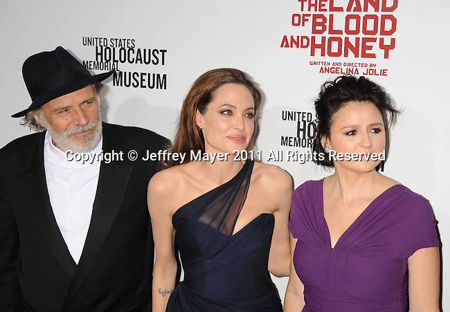 HOLLYWOOD, CA - DECEMBER 08: Rade Serbedzija, Angelina Jolie, Vanesa Glodjo attend 'In The Land Of Blood And Honey' Los Angeles Premiere at ArcLight Cinemas Hollywood on December 8, 2011 in Hollywood, California.