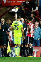 Nico Yennaris of Brentford is booked for his involvement in the fracas during the Sky Bet Championship match between Brentford and Derby County at Griffin Park, London, England on 26 September 2017. Photo by Carlton Myrie / PRiME Media Images.
