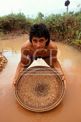 Boi Morto diamond mine, Diamantino, Mato Grosso State, Brazil. Young man panning for diamonds.