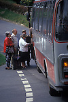 Eastleach Turville, Gloucestershire, England. Traditional village annual fete. The bus service to the local town runs an infrequent service, elderly members of the community queue to join the afternoon bus into town.