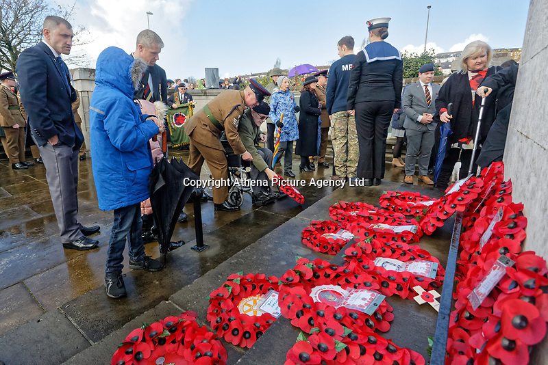 Pictured: A war veteran lays a wreath after the service. Sunday 11 November 2018<br /> Re: Commemoration for the 100 years since the end of the First World War on Remembrance Day at the Swansea Cenotaph in south Wales, UK.