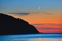 SHoreline along the Gulf of St. Lawrence at sunrise with crescent moon<br />