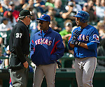 Texas Rangers' Manager Ron Washington, center, argues with Home Plate Umpire Gary Darling after Cruz was thrown out against the Seattle Mariners' in the sixth inning April 14, 2013 at Safeco Field in Seattle.  © 2013. Jim Bryant Photo. All Rights Reserved.