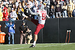 Washington State punter, Oscar Draguicevich, punts during the Cougs big road victory over the Colorado Buffaloes.