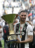 Calcio, Serie A: Juventus - Hellas Verona, Torino, Allianz Stadium, 19 maggio, 2018.<br /> Juventus' Mattia De Sciglio celebrates with the trophy during the victory league ceremony at Torino's Allianz stadium, 19 May, 2018.<br /> Juventus won their 34th Serie A title (scudetto) and seventh in succession.<br /> UPDATE IMAGES PRESS/Isabella Bonotto
