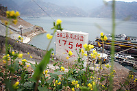CHINA. Chongqing Province. A marker indicating where water levels will rise too once the 3 Gorges dam is flooded to capacity. The flooding of the three Gorges, by damming the Yangtze near the town of YiChang, has remained a controversial subject due to the negative environmental consequences and the displacement of millions of people in the flood plain. The Yangtze River however is reported to be at its lowest level in 150 years as a result of a country-wide drought. It is China's longest river and the third longest in the world. Originating in Tibet, the river flows for 3,964 miles (6,380km) through central China into the East China Sea at Shanghai.  2008.