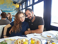 Pictured: Valantis Barkas (R), the son of digger driver Konstantinos Barkas with his wife Ioanna in Kos, Greece.<br />