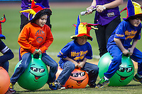 Kids compete in a contest between innings of the Carolina League game between the Wilmington Blue Rocks and the Winston-Salem Dash at BB&T Ballpark on April 5, 2014 in Winston-Salem, North Carolina.  The Dash defeated the Blue Rocks 3-2.  (Brian Westerholt/Four Seam Images)