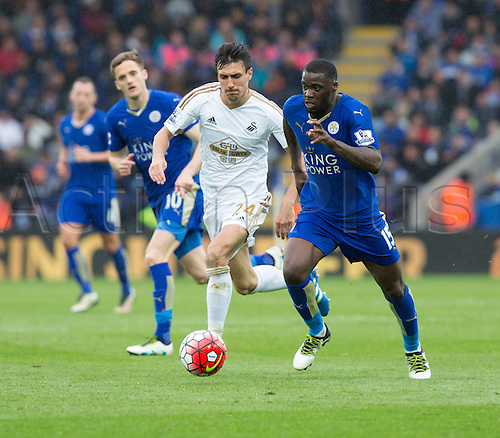 24.04.2016. King Power Stadium, Leicester, England. Barclays Premier League. Leicester versus Swansea.  Leicester City midfielder Jeff Schlupp on the attack with  the ball chased by Swansea City midfielder Jack Cork.