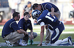 Medical staff tend to Nevada's Cody Fajardo (17) after he was injured playing against Wyoming during the first half of an NCAA college football game in Reno, Nev., on Saturday, Oct. 6, 2012. Fajardo didn't return to the game due to back spasms. (AP Photo/Cathleen Allison)