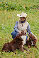 Ranch hand with her dogs