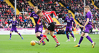 Lincoln City's Shay McCartan under pressure from Grimsby Town's Alex Whitmore<br /> <br /> Photographer Chris Vaughan/CameraSport<br /> <br /> The EFL Sky Bet League Two - Lincoln City v Grimsby Town - Saturday 19 January 2019 - Sincil Bank - Lincoln<br /> <br /> World Copyright © 2019 CameraSport. All rights reserved. 43 Linden Ave. Countesthorpe. Leicester. England. LE8 5PG - Tel: +44 (0) 116 277 4147 - admin@camerasport.com - www.camerasport.com
