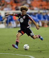 Nick DeLeon (18) of D.C. United takes a shot on goal during the game at RFK Stadium in Washington DC.   D.C. United defeated the Montreal Impact, 3-0.