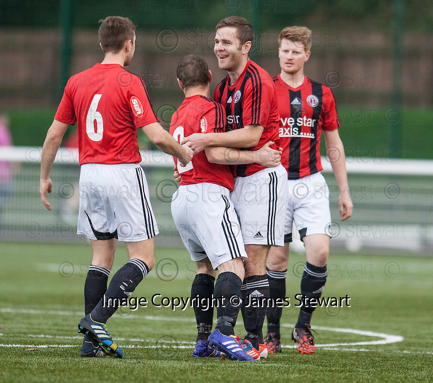 Gala's Ross Aitchison (3rd left) is congratulated by Lee Stephen (2) and Grant Robinson (6) after he scores their first goal.