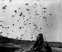 Paratroopers of the 187th RCT (Regimental Combat Team) float earthward from C-119's to cut off retreating enemy units south of Munsan, Korea.  March 23, 1951.  Cpl. P. T. Turner.  (Army)<br /> NARA FILE #:  111-SC-362121<br /> WAR &amp; CONFLICT BOOK #:  1428