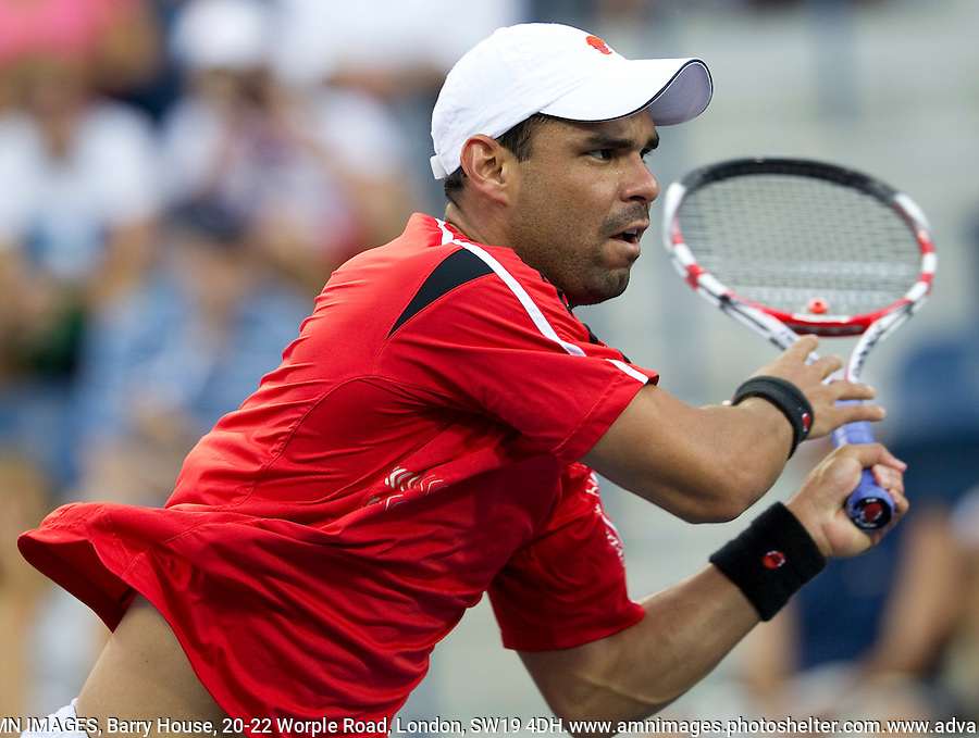 ALEJANDRO FALLA (COL) against VIKTOR TROICKI (SRB) (15) in the 1st round of the men's singles. Alejandro .Falla beat Viktor Troicki 3-6 6-3 4-6 7-6 7-5..Tennis - Grand Slam - US Open - Flushing Meadows - New York - Day 01 - Mon August 29th  2011..© AMN Images, Barry House, 20-22 Worple Road, London, SW19 4DH, UK..+44 208 947 0100.www.amnimages.photoshelter.com.www.advantagemedianetwork.com.