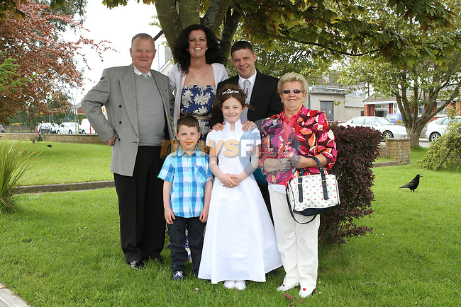 Katie Duffy McGuirk with her family at the Communion in Holy Family Church...(Photo Jenny Matthews/www.newsfile.ie)
