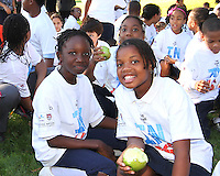 "Kids eat apples during a  D.C United clinic in support of first lady Michelle Obama's ""Let's Move"" initiative on the White House lawn, in Washington D.C. on October 7 2010."