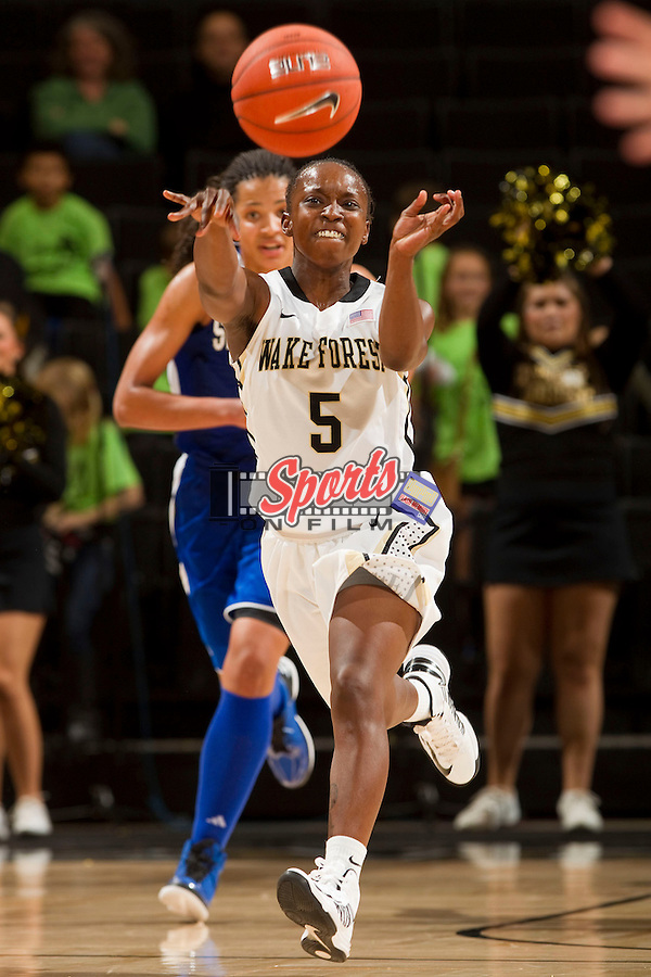 Chelsea Douglas (5) of the Wake Forest Demon Deacons fires a pass up the court during second half action against the Seton Hall Pirates at the LJVM Coliseum on December 8, 2012 in Winston-Salem, North Carolina.  The Demon Deacons defeated the Pirates 64-63.    (Brian Westerholt/Sports On Film)