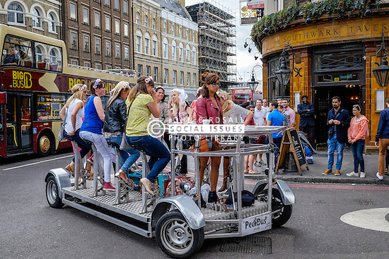 A hen party travelling on a PediBus in Borough, Southwak, London.
