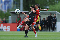 Olivia Chance of New Zealand Women's vies for possession with Natasha Harding of Wales Women's' during the Women's International Friendly match between Wales and New Zealand at the Cardiff International Sports Stadium in Cardiff, Wales, UK. Tuesday 04 June, 2019