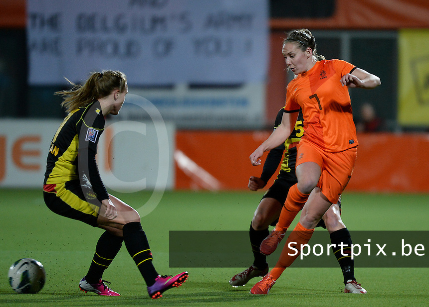 20140212 - ZWOLLE , THE NETHERLANDS : Dutch Manon Melis (r)  pictured during the female soccer match between The Netherlands and Belgium , on the fifth matchday in group 5 of the UEFA qualifying round to the FIFA Women World Cup in Canada 2015 at Het Ijseldelta Stadion , Zwolle . Wednesday 12th February 2014 . PHOTO DAVID CATRY