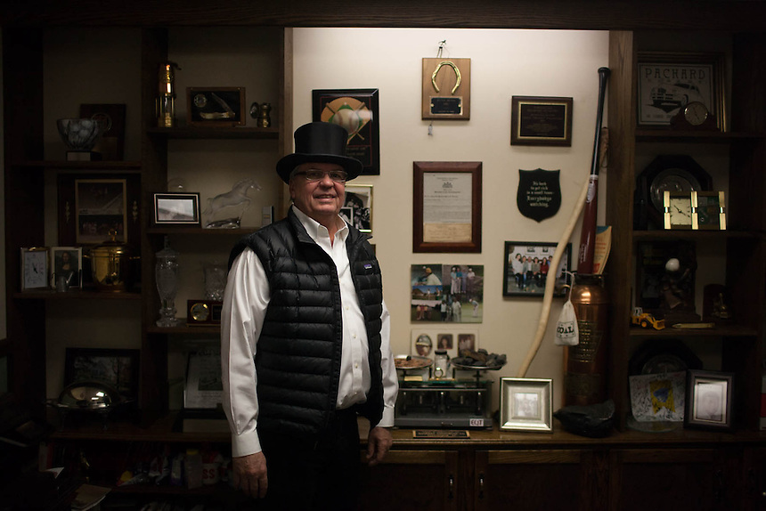 Inner Circle member, (name), and owner of P&M Coal, sits at his desk in his office in Punxsutawney, PA.