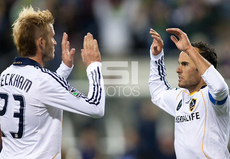 SEATTLE, WA--LA Galaxy teammates David Beckham, left, and Landon Donovan, right, celebrate their goal in the first half of the MLS Cup championships at Qwest field in Seattle. SUNDAY, NOVEMBER 22, 2009. PHOTO BY DON FERIA.
