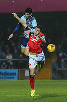 Joe Jacobson of Wycombe Wanderers wins the aerial battle during the Sky Bet League 2 match between Wycombe Wanderers and Morecambe at Adams Park, High Wycombe, England on 12 November 2016. Photo by David Horn.