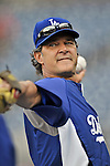 20 September 2012: Los Angeles Dodgers Manager Don Mattingly takes some warmup tosses during batting practice prior to a game against the Washington Nationals at Nationals Park in Washington, DC. The Nationals defeated the Dodgers 4-1, clinching a playoff birth: the first time for a Washington franchise since 1933. Mandatory Credit: Ed Wolfstein Photo
