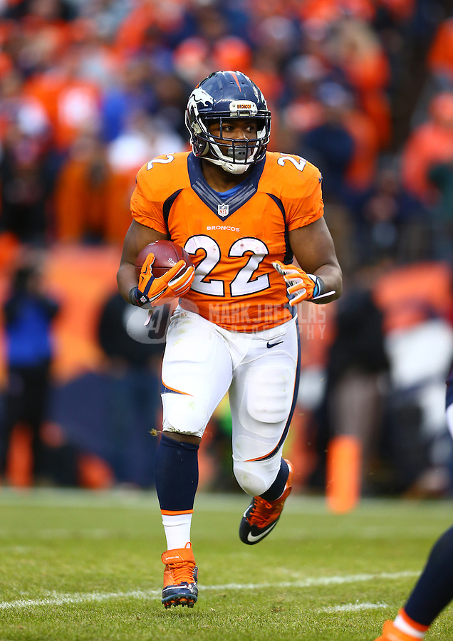 Jan 24, 2016; Denver, CO, USA; Denver Broncos running back C.J. Anderson (22) against the New England Patriots in the AFC Championship football game at Sports Authority Field at Mile High. The Broncos defeated the Patriots 20-18 to advance to the Super Bowl. Mandatory Credit: Mark J. Rebilas-USA TODAY Sports