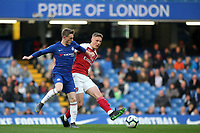 Danny Ballard of Arsenal passes the ball under pressure from Chelsea's Charlie Brown during Chelsea Under-23 vs Arsenal Under-23, Premier League 2 Football at Stamford Bridge on 15th April 2019