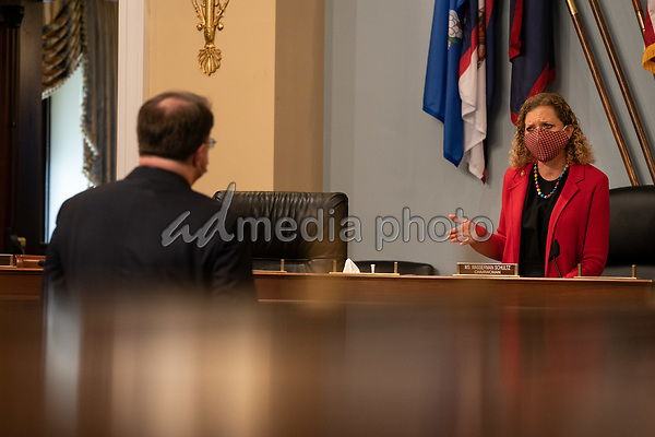 Chairwoman United States Representative Debbie Wasserman Schultz (Democrat of Florida), right, speaks with US Secretary of Veterans Affairs (VA) Robert Wilkie, left, before the start of a hearing with the US House Appropriations Subcommittee on Military Construction, Veterans Affairs, and Related Agencies on Capitol Hill in Washington DC, on May 28th, 2020.<br /> Credit: Anna Moneymaker / Pool via CNP/AdMedia