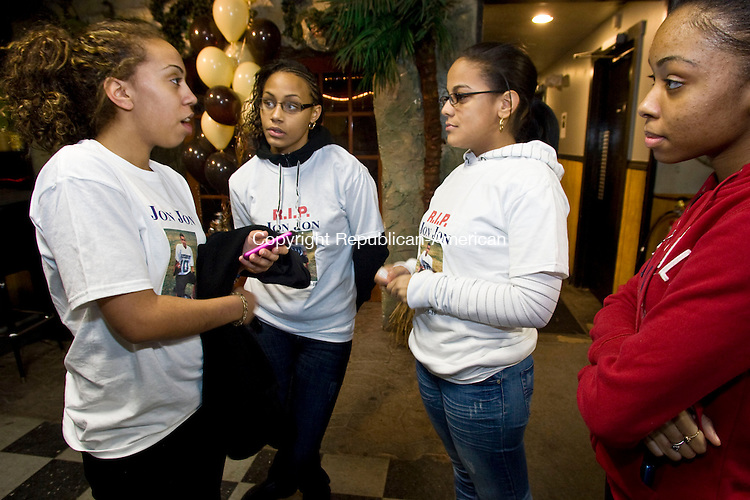 WATERBURY, CT - 23 JANUARY 2010 -012310JT09--<br /> From left, Zilka Navarro, Sicora Johnson, Evalix Gonzalez, and Tanisha Barjon, all 16, attend a party for their friend John Frazier, who was gunned down on his 17th birthday on Monday in front of his Waterbury home. The party was held at Paradise Cafe on Saturday to raise money for a scholarship fund in Frazier's name.<br /> Josalee Thrift Republican-American