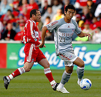 FC Dallas defender Alex Yi (21) dribbles the ball away from Chicago Fire forward Pascal Bedrossian (13).  FC Dallas defeated the Chicago Fire 2-1 at Toyota Park in Bridgeview, IL on May 17, 2007.