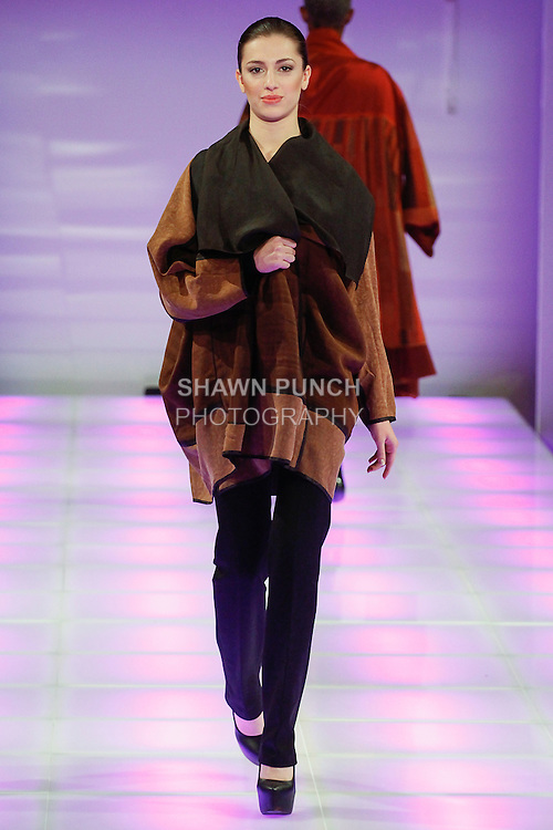 Model walks runway in an outfit from the Yasmine Desings Fall Winter 2014 collection, by Yasmine Rana, during Couture Fashion Week Fall 2014, on February 14, 2014.