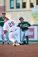 Daytona Tortugas second baseman Randy Ventura (1) throws to first base as Alexis Wilson (26) slides in during a Florida State League game against the Palm Beach Cardinals on April 11, 2019 at Roger Dean Stadium in Jupiter, Florida.  Palm Beach defeated Daytona 6-0.  (Mike Janes/Four Seam Images)