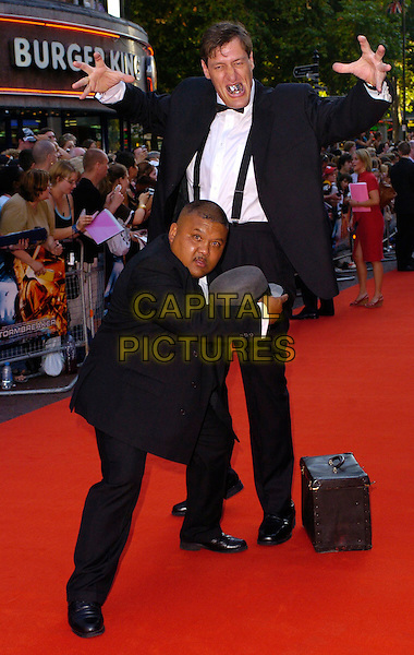 "ODDJOB & JAWS.The ""Stormbreaker"" world premiere at Vue West End, London, UK..July 17th, 2006.Ref: CAN.full length funny black suits hat hands james bond characters.www.capitalpictures.com.sales@capitalpictures.com.©Capital Pictures"