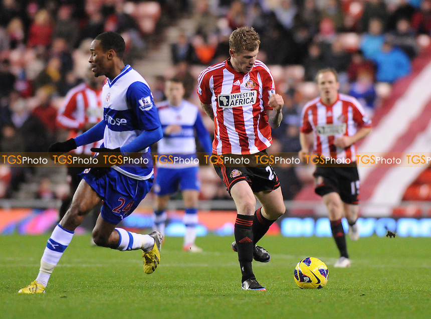 Sunderland's James McClean battles with Shaun Cummings of Reading - Sunderland vs Reading - Barclays Premier League Football at The Stadium of Light, Sunderland, Tyne & Wear - 11/12/12 - MANDATORY CREDIT: Steven White/TGSPHOTO - Self billing applies where appropriate - 0845 094 6026 - contact@tgsphoto.co.uk - NO UNPAID USE.