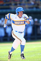 Ty Moore (29) of the UCLA Bruins runs to first base during a game against the Oregon State Beavers at Jackie Robinson Stadium on April 4, 2015 in Los Angeles, California. UCLA defeated Oregon State, 10-5. (Larry Goren/Four Seam Images)