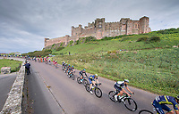 Picture by Allan McKenzie/SWpix.com - 04/09/2017 - Cycling - OVO Energy Tour of Britain - Stage 2 Kielder Water to Blyth - Peloton in front of Bamburgh Castle.