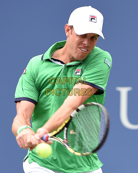 FLUSHING NY- AUGUST 30:  Novak Djokovic Vs Sam Querrey on Arthur Ashe stadium at the USTA Billie Jean King National Tennis Center. Sam Querrey returns a volley against Novak Djokovic during their match on August 30, 2014 in Flushing Queens. <br /> CAP/MPI/MPI04<br /> &copy;MPI04/MPI/Capital Pictures