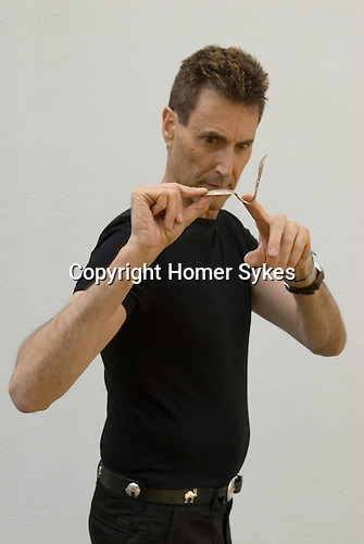 Uri Geller at home Berkshire England 2008. Bending spoon 1st image taken at 16. 37. 36 pm.