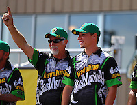 Jul 24, 2016; Morrison, CO, USA; NHRA pro stock driver Alex Laughlin (right) with crew members during the Mile High Nationals at Bandimere Speedway. Mandatory Credit: Mark J. Rebilas-USA TODAY Sports
