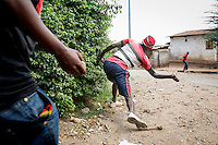 Bujumbura, BURUNDI  05/06/15 A protester throws a rock toward police before they open fire in the backstreets of the Musaga neighbourhood in Bujumbura, Burundi on what was supposed to be voting day for parliamentary and local elections. However President Nkurunziza has delayed this process - which was greeted by even more protesting which saw one protester confirmed shot dead by police. Demonstrations have been against President Pierre Nkurunziza trying for a controversial third term as leader. Approximately 90,000 people have fled the unrest which has seen 41 protesters killed by police and army officers. Rick Findler / Story Picture Agency